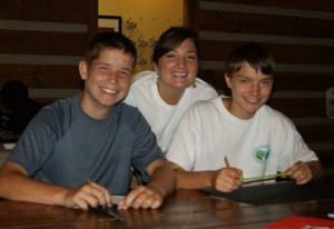 Kayla and boys smiling at adhd boarding school